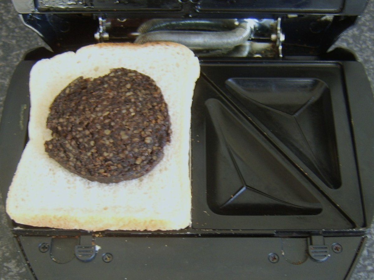 Cooled haggis slice is laid on first slice of bread