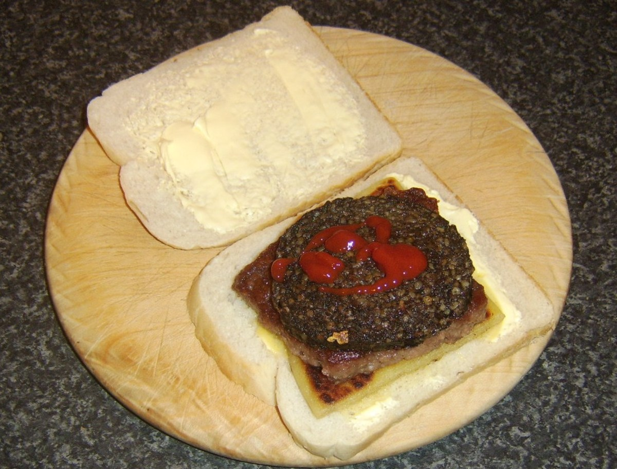 Ketchup is optional on a haggis, Lorne sausage and tattie scone sandwiuch