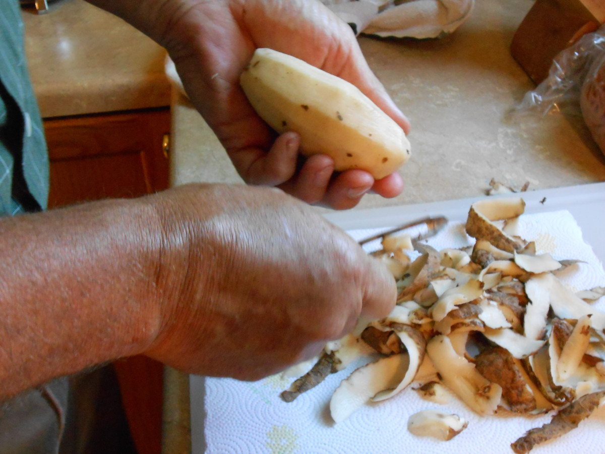 Remove skin from potatoes using a vegetable peeler.
