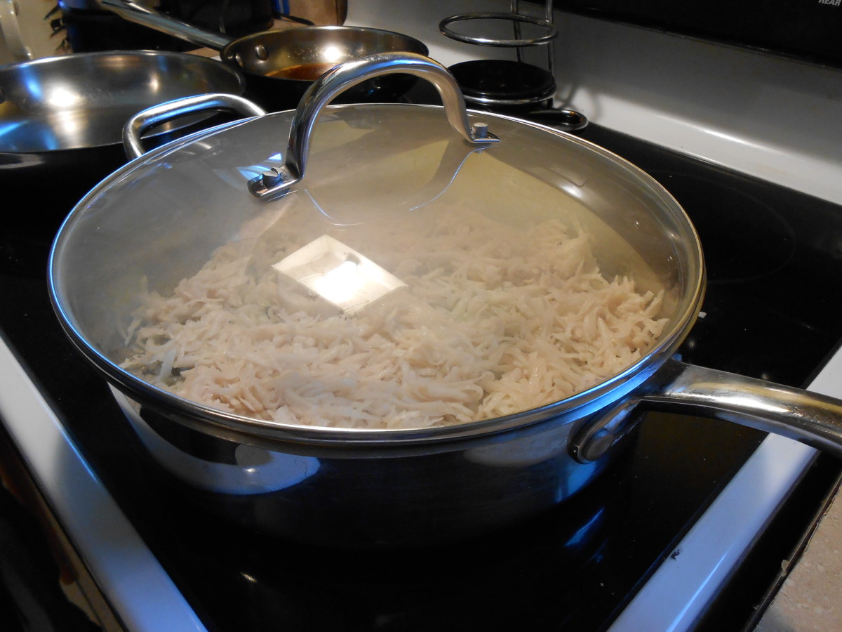 Cook hash browns covered for 8 minutes on medium heat.  Uncover and flip hash browns.  Cook uncovered for 6 more minutes.