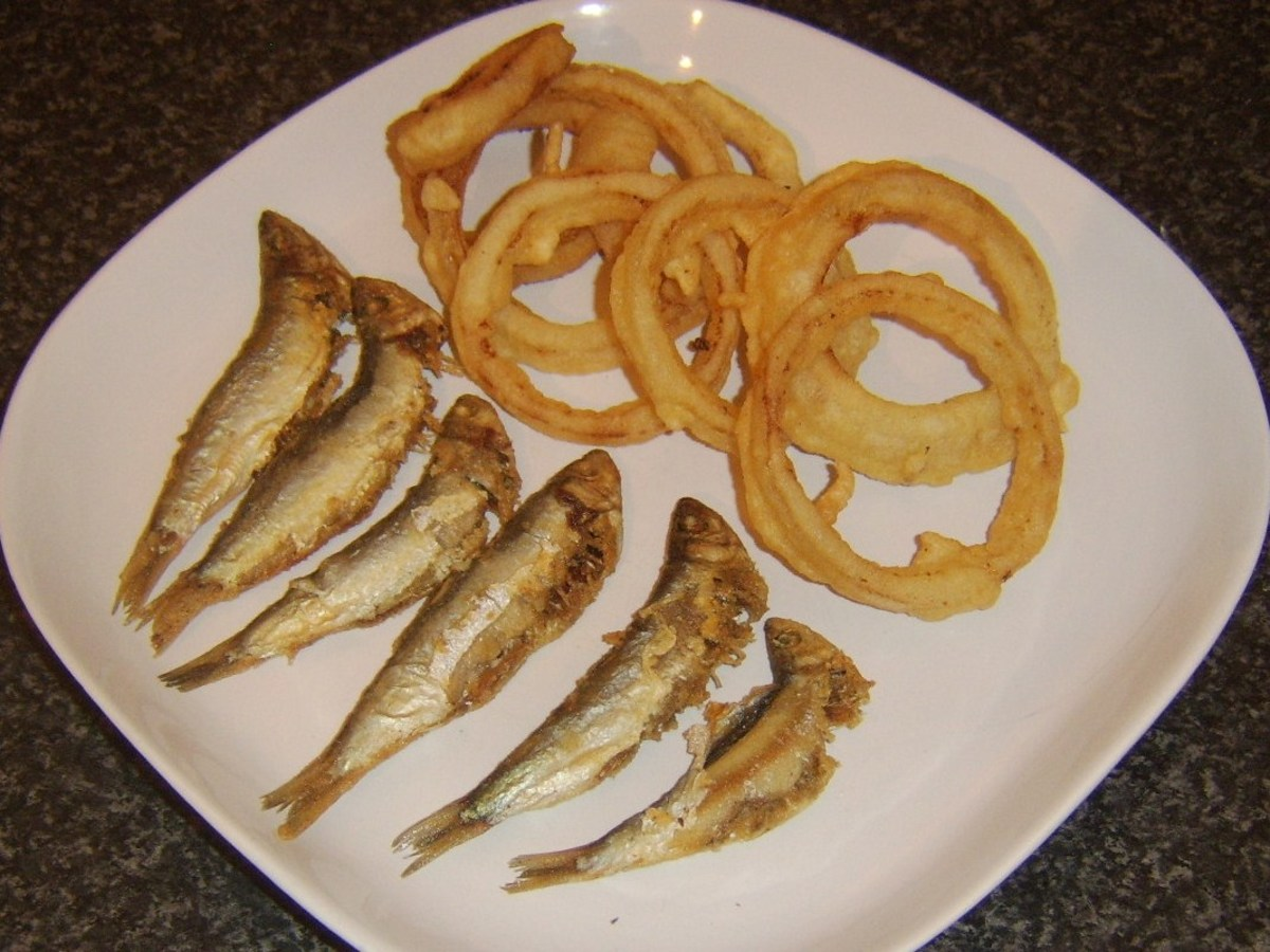 Spicy shallow fried sprats with deep fried onion rings