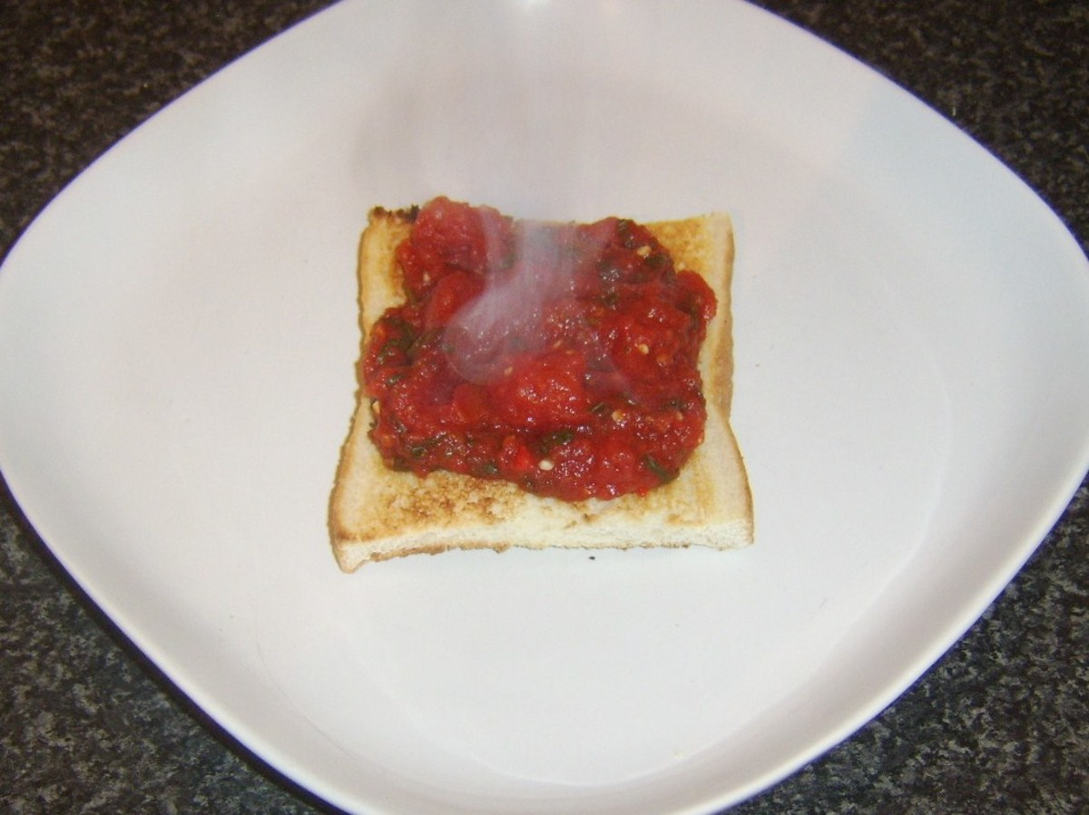Spicy tomato sauce is spooned on to toast