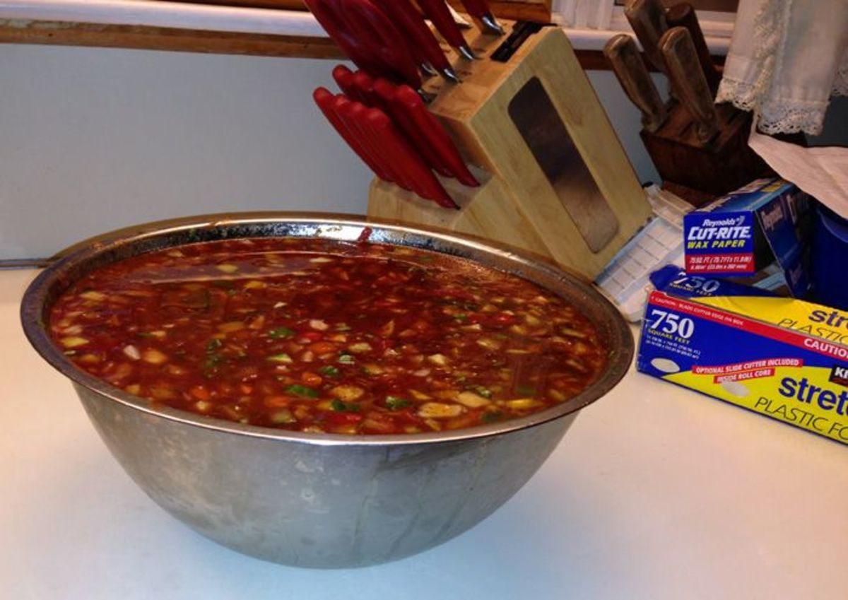 Bowl of gazpacho soup with plastic wrap