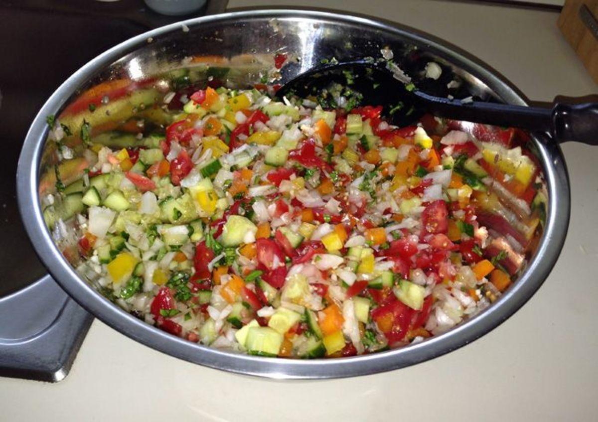 Chopped veggies, tomatoes and herbs for gazpacho