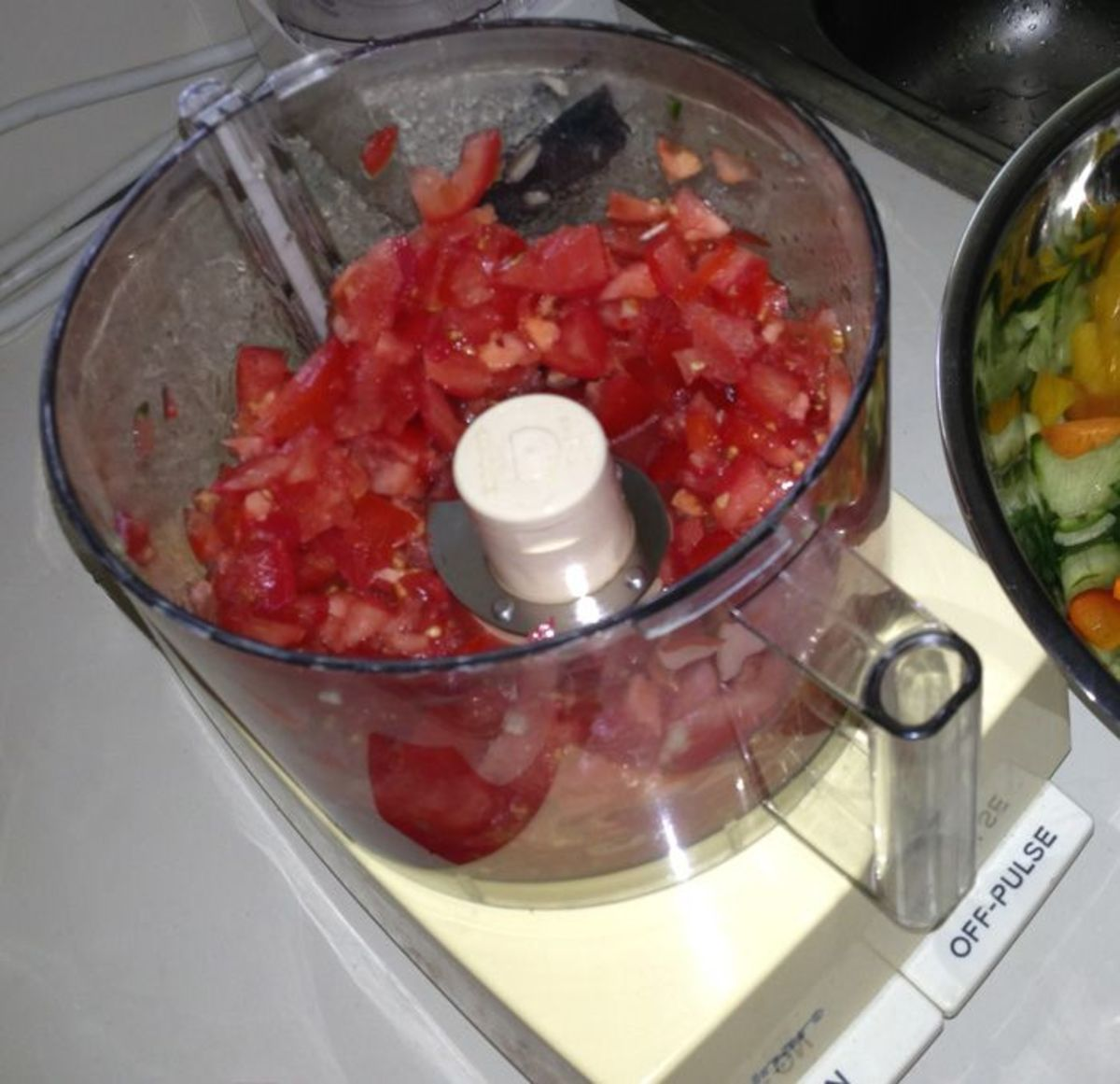 Coarsely chopped tomatoes in food processor
