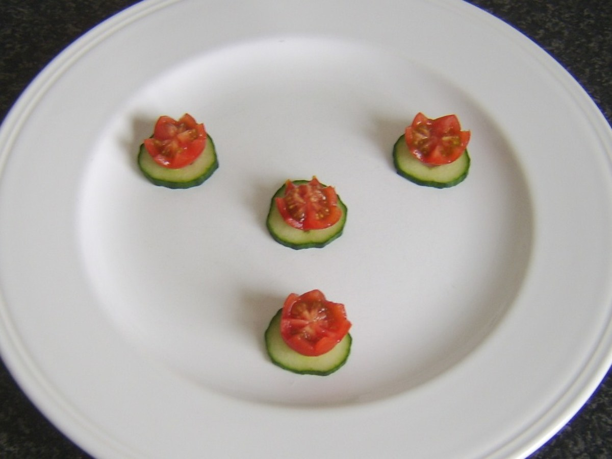 Cherry tomato and cucumber garnish is plated