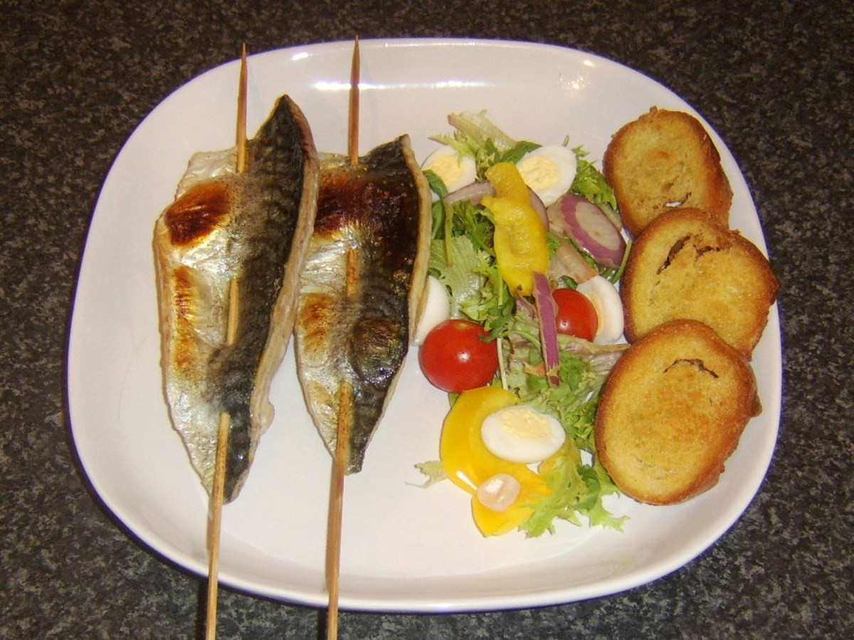 Skewered mackerel fillets re served with a simple hard boiled quail eggs based salad