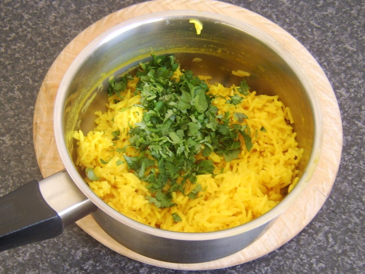 Coriander is added to drained rice