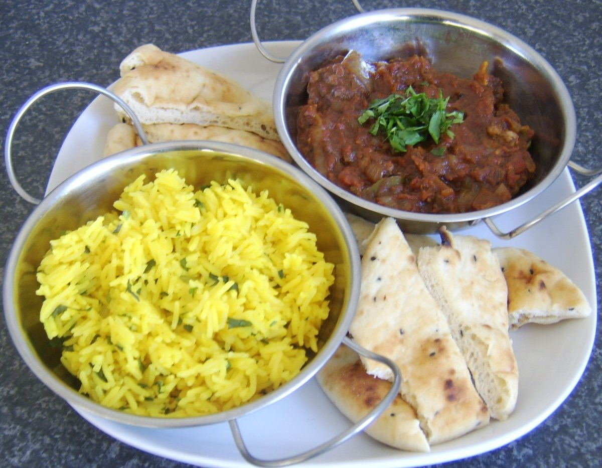 Bhuna lamb served with fragrant rice and naan bread