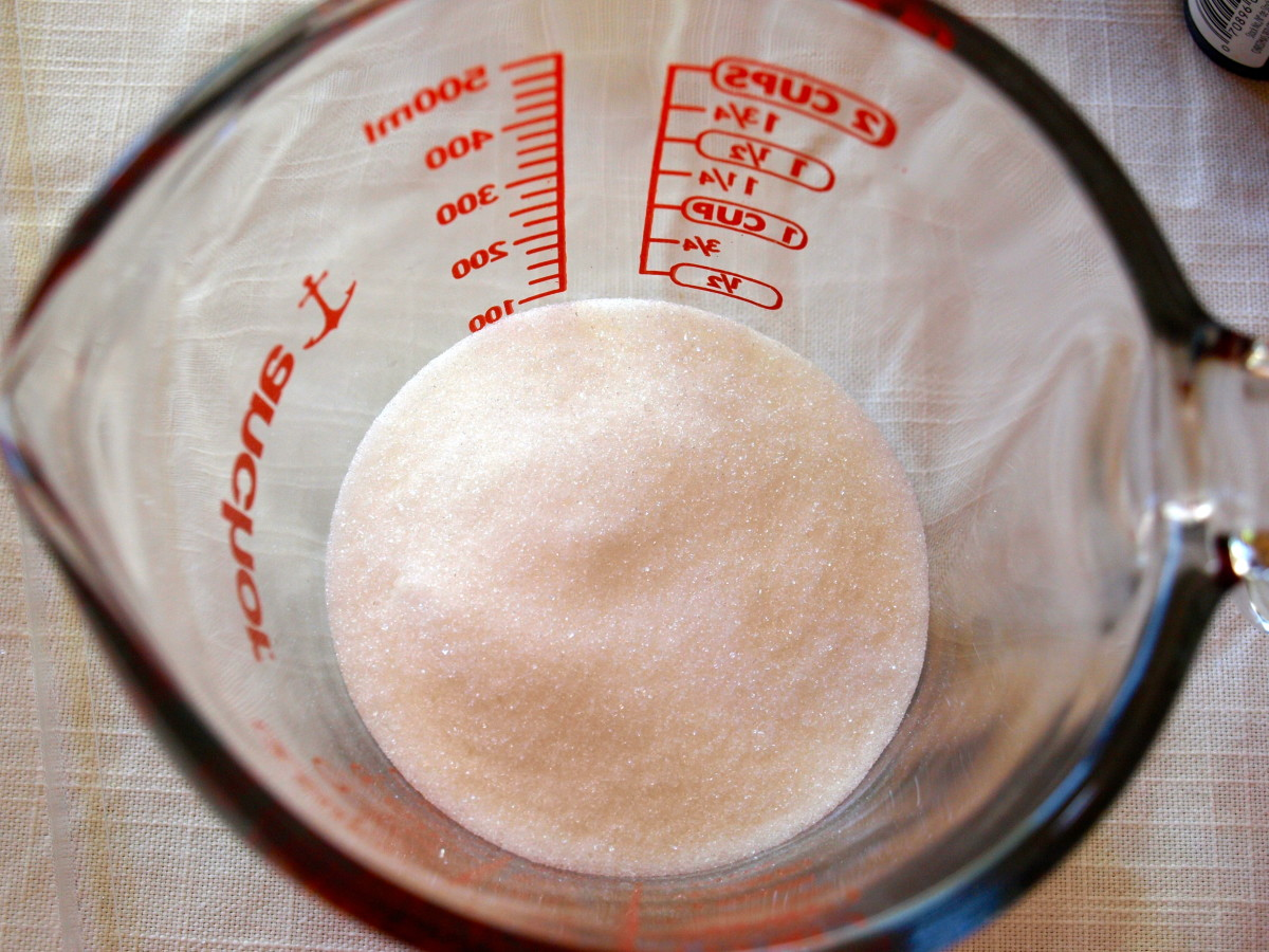 Pour 1/2 cup of sugar into a measuring cup or small bowl.