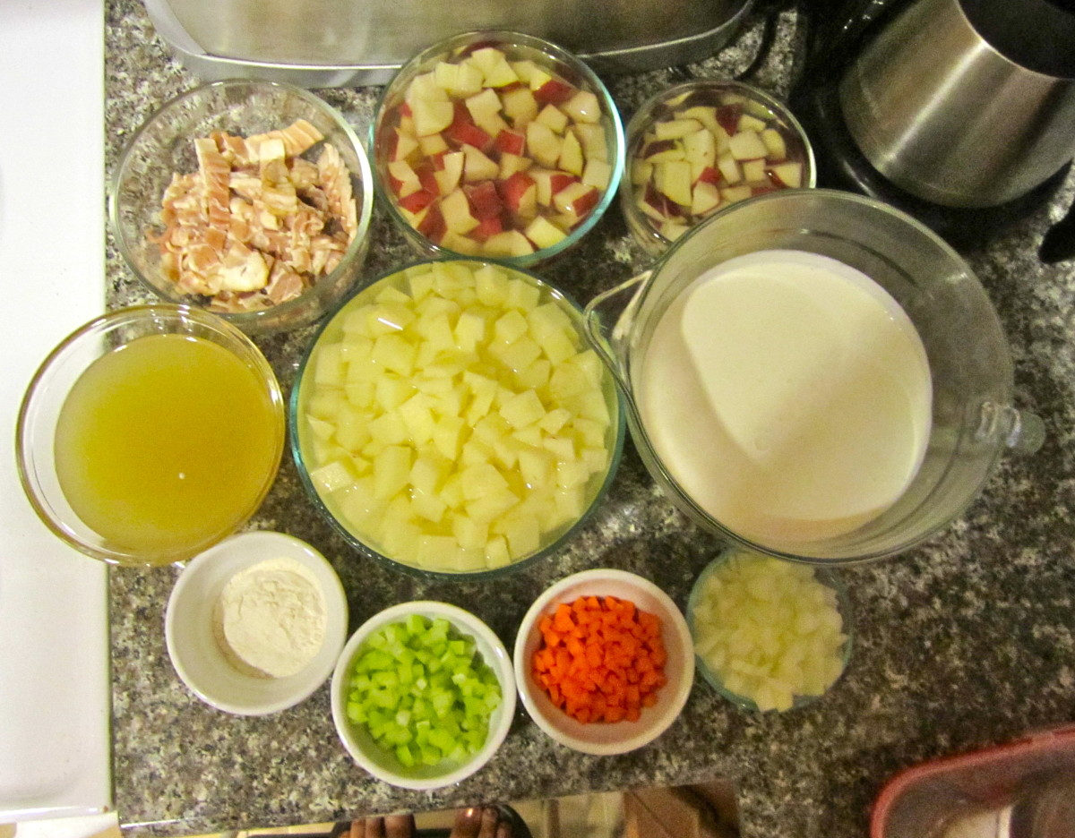 All the ingredients needed to make loaded baked potato soup: carrots, celery, potatoes, heavy cream, onion, flour, bacon, and chicken broth. This does not include garnishes.