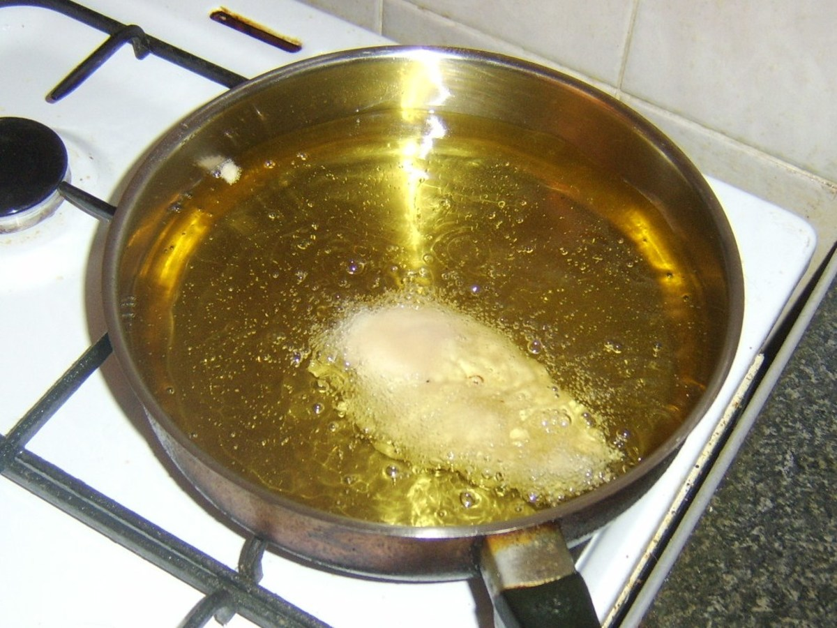 Deep frying battered chicken breast