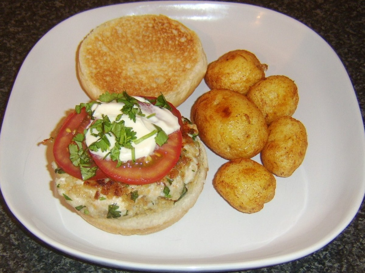 Succulent chicken breast, spice, and herb burger served with crispy roast potatoes.