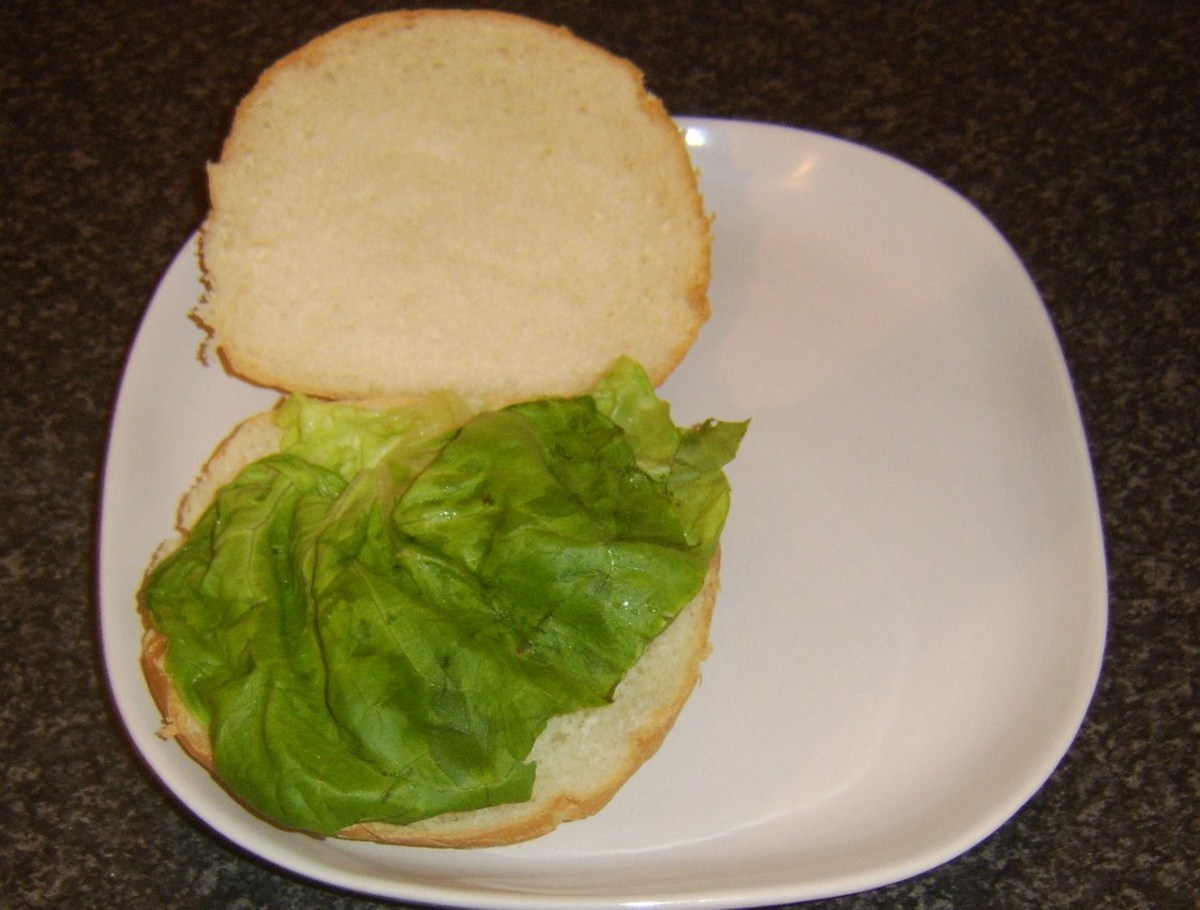 Lettuce bed is formed on bread roll