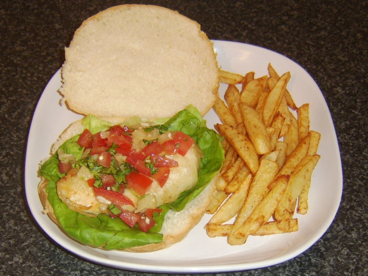Battered chicken breast burger with pineapple salsa and fries.