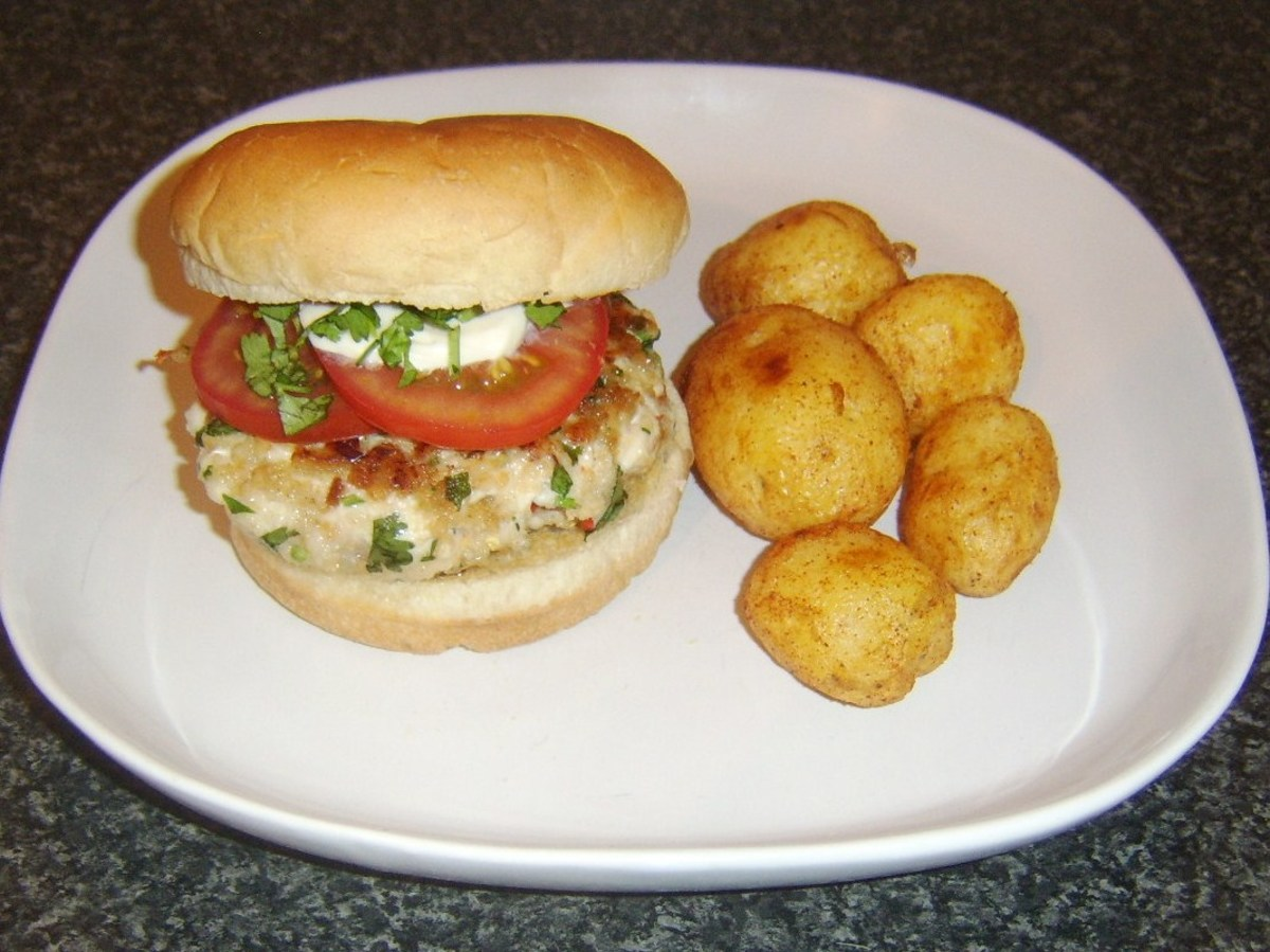 Spicy chicken burger and roast potatoes is ready to eat