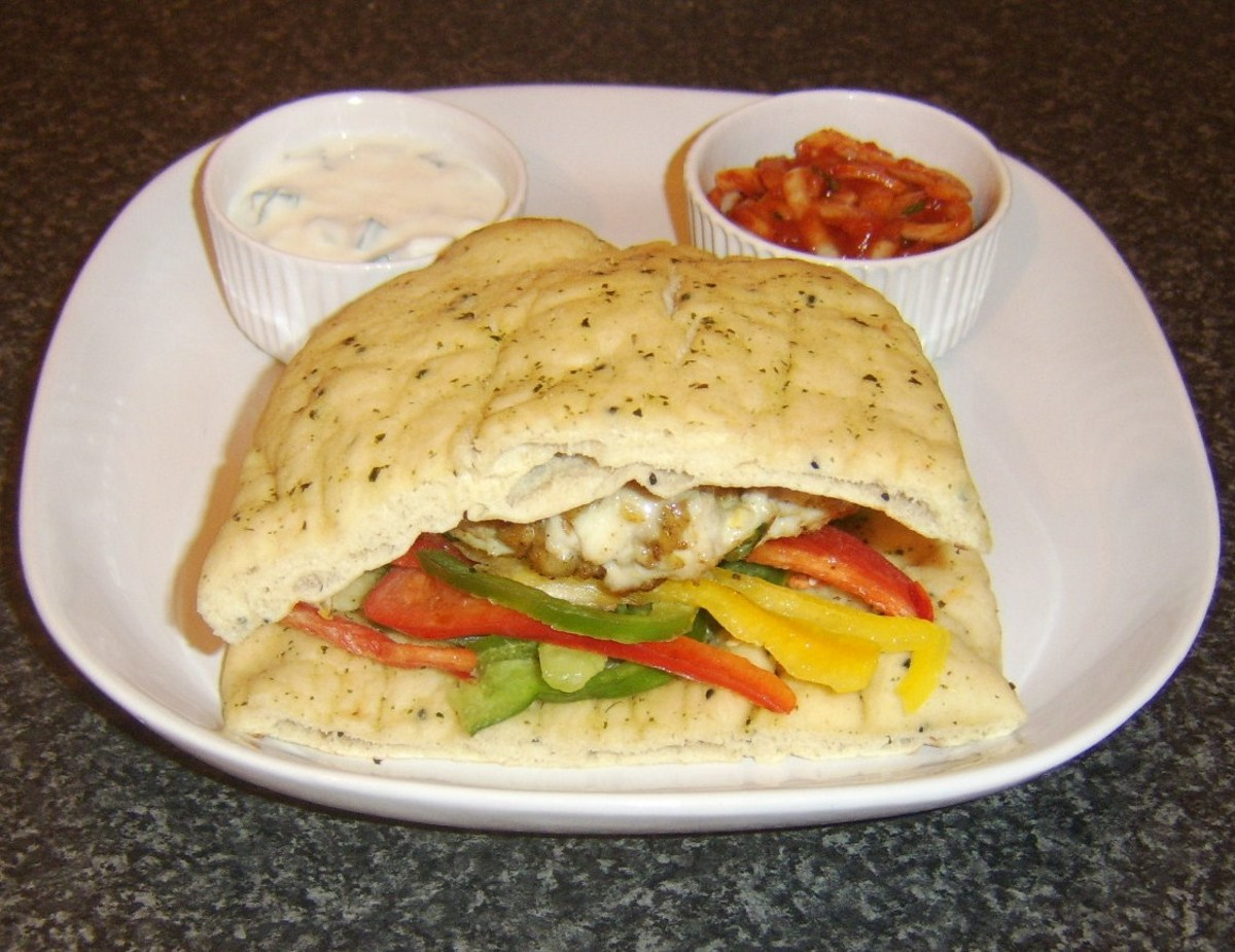 CUrried chicken burger served in naan bread with mango chutney, spiced onions and raita