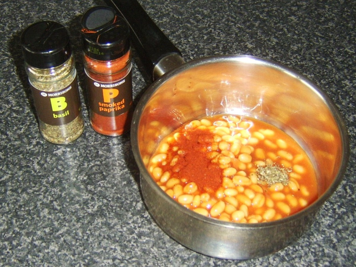 Smoked paprika and basil are added to baked beans in tomato sauce