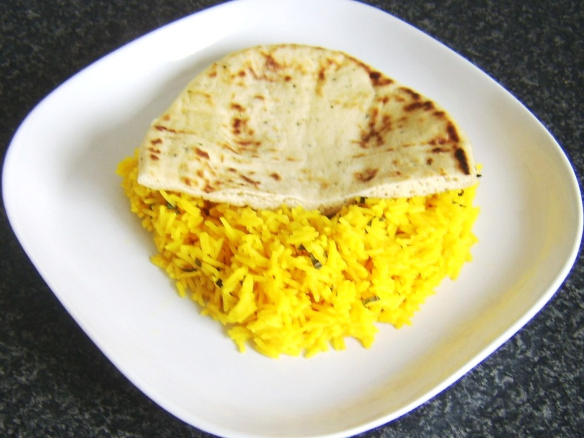 Half naan is laid on rice bed