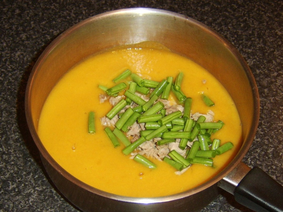 Chopped green beans and turkey are added to soup