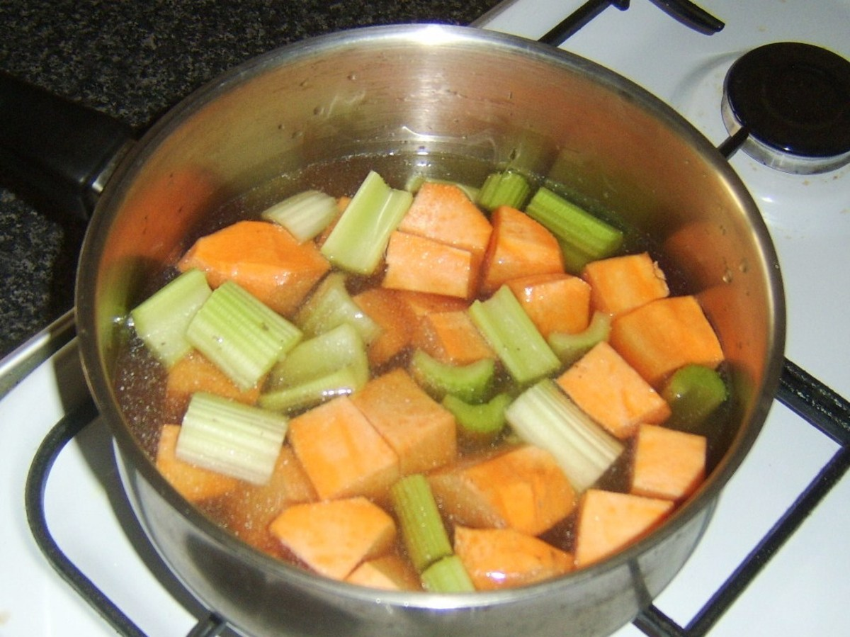 Chopped celery and sweet potato added to turkey stock