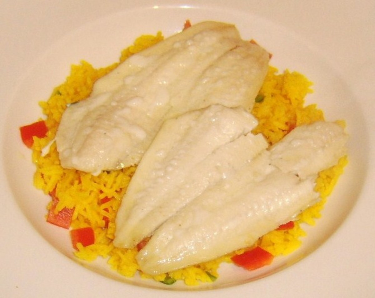 Plaice fillets are lifted on to spicy rice bed