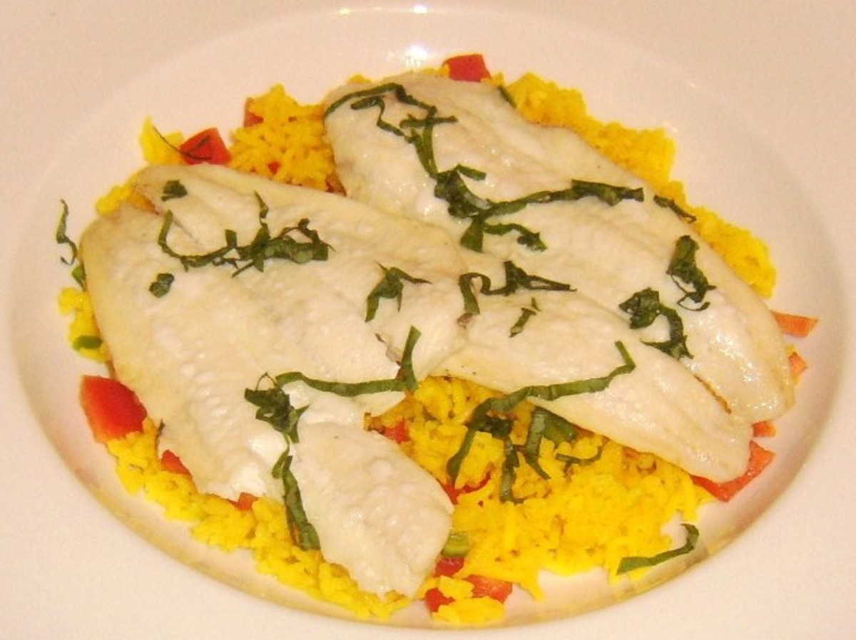 Simply fried fillets of plaice served on a bed of spicy pepper rice