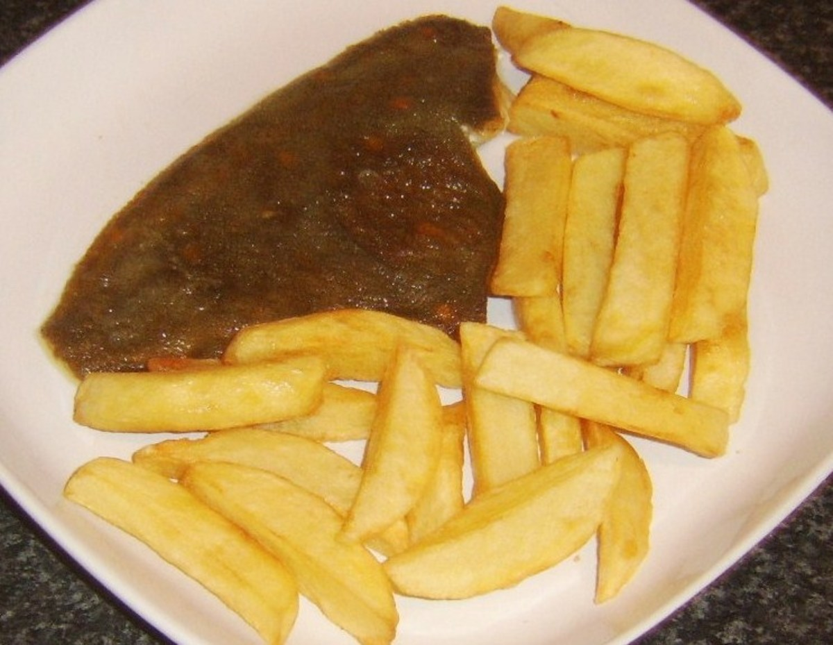 Chips are plated with plaice fillet