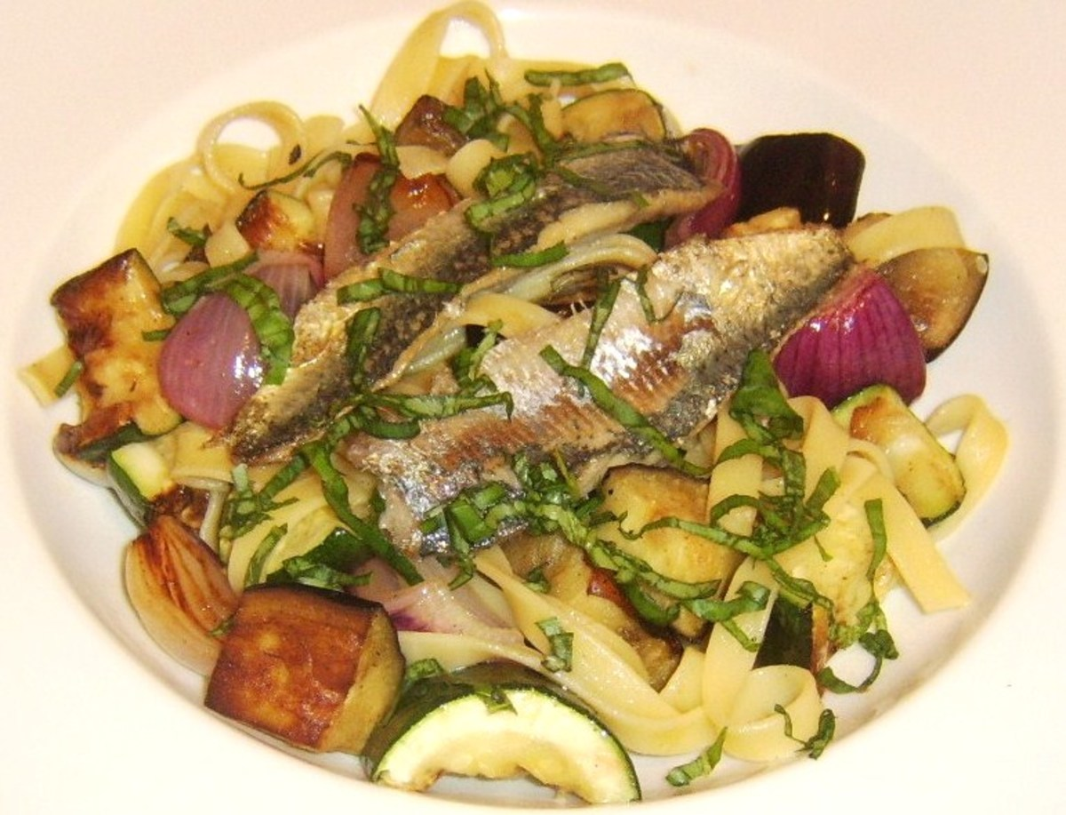 Freshly roasted vegetables are stirred through tagliatelle pasta and served with pan fried sardines