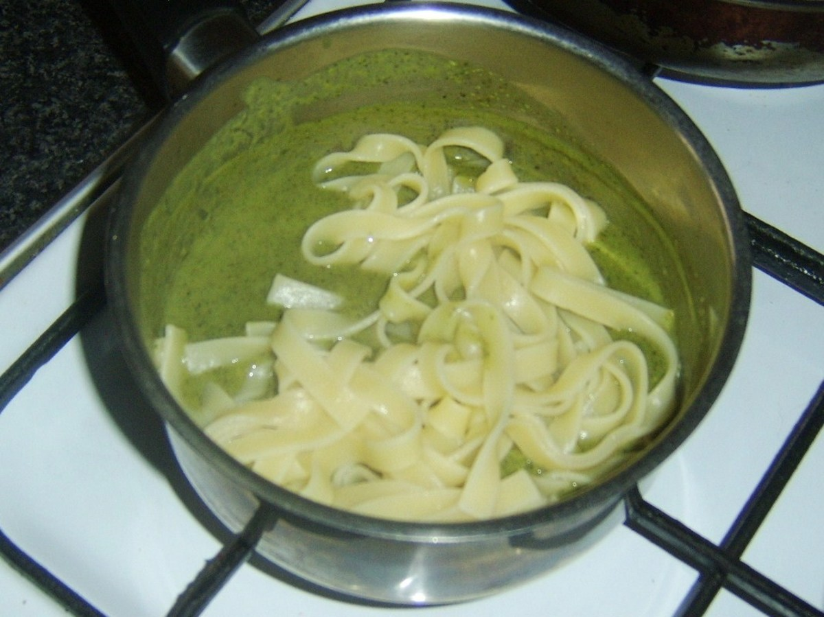 Cooked tagliatelle is added to pea and mint sauce