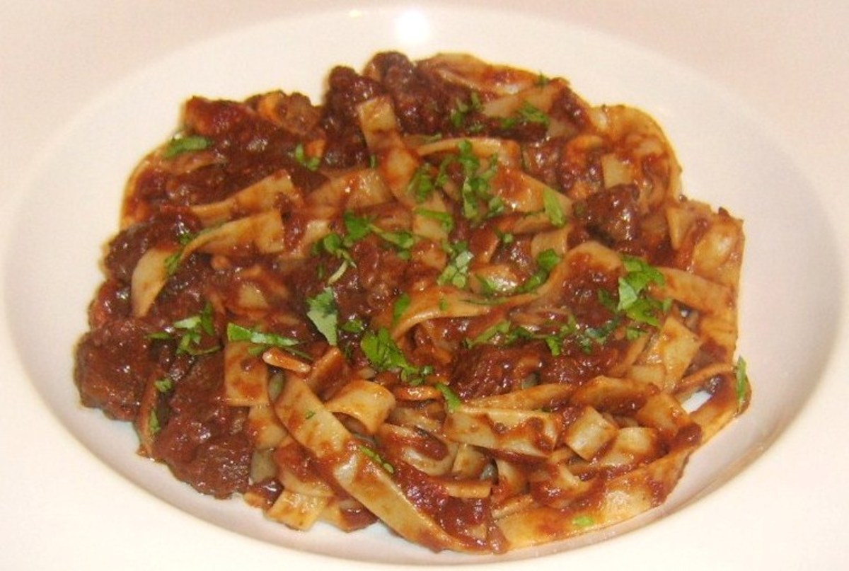 Tagliatelle pasta is served with a rich beef and red wine sauce