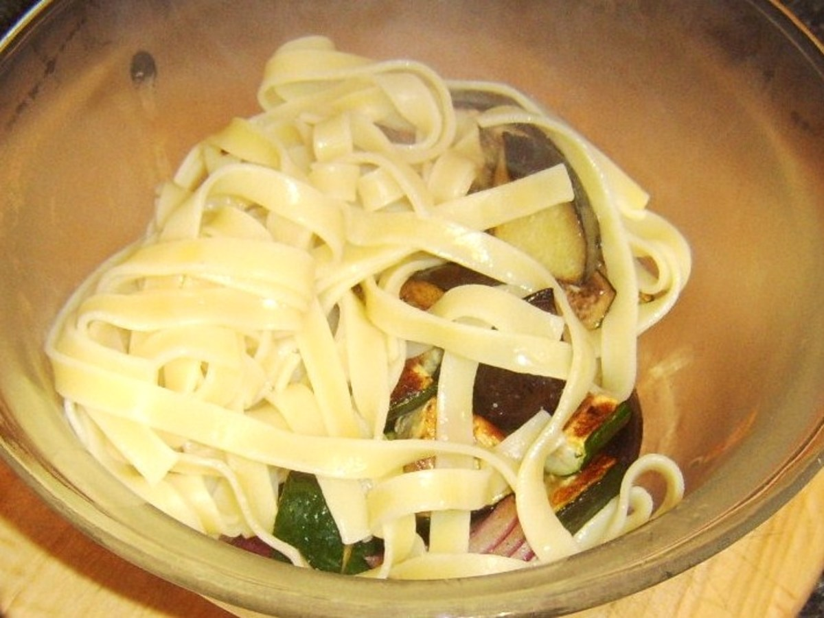 Tagliatelle is added to roasted vegetables