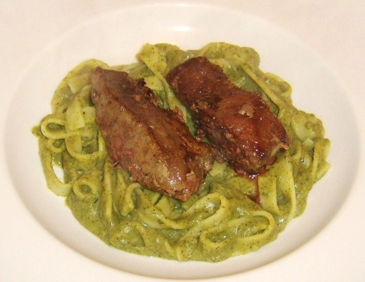 Lambs liver is laid on bed of tagliatelle pasta in pea and mint sauce
