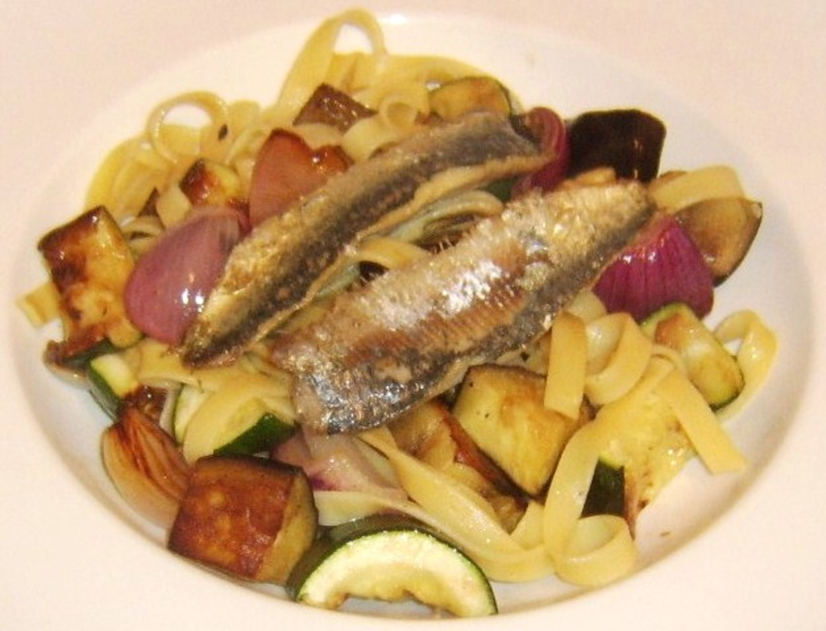 Sardine fillets are laid on tagliatelle and vegetables