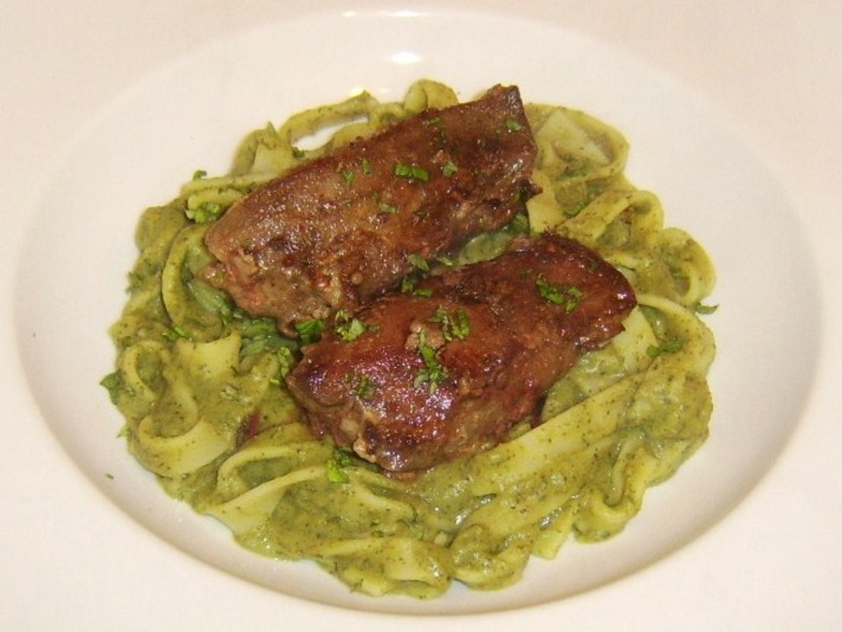 Tender lambs liver served on a bed of tagliatelle in pea and mint sauce