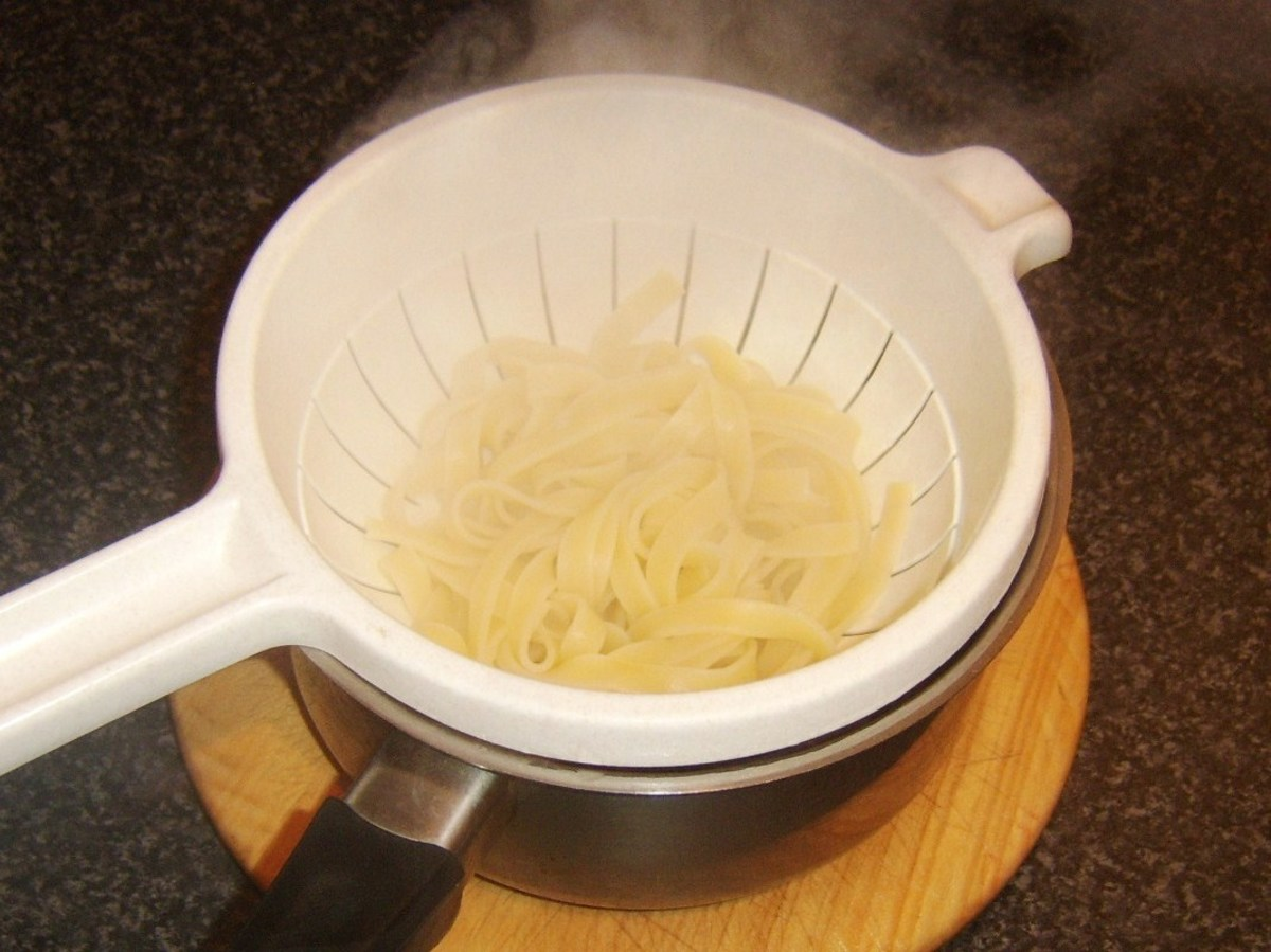 Cooked tagliatelle pasta is drained