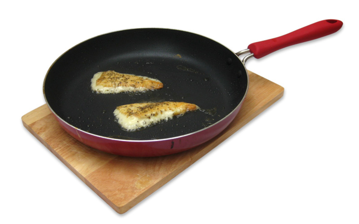 Frying the saganaki. In this case, there is too much olive oil in the frypan. There should only be a smear of oil, otherwise the cheese melts quicker and you have less chance of getting that crispy golden skin.