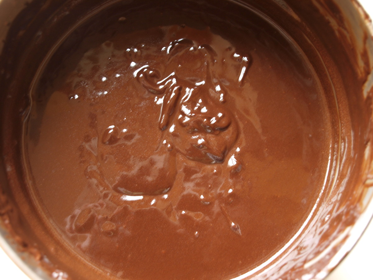 In a double boiler, melt the chocolate squares and the butter.