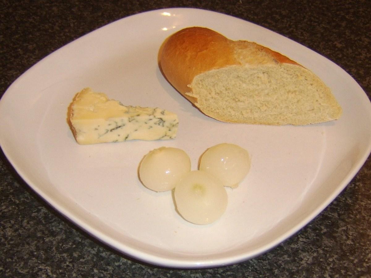 Basic ploughman's lunch incorporating Stilton cheese