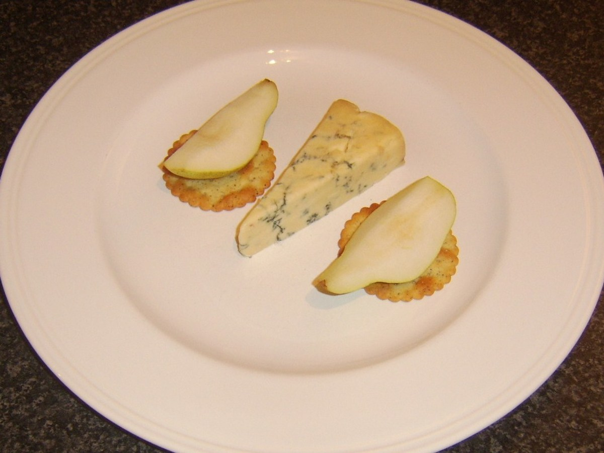 Pears are laid on crackers either side of Stilton wedge
