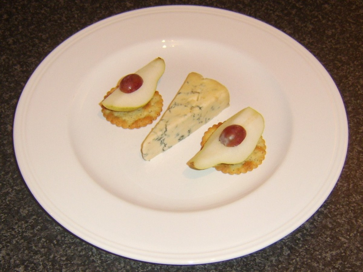 Pear quarters on crackers are served with Stilton and port