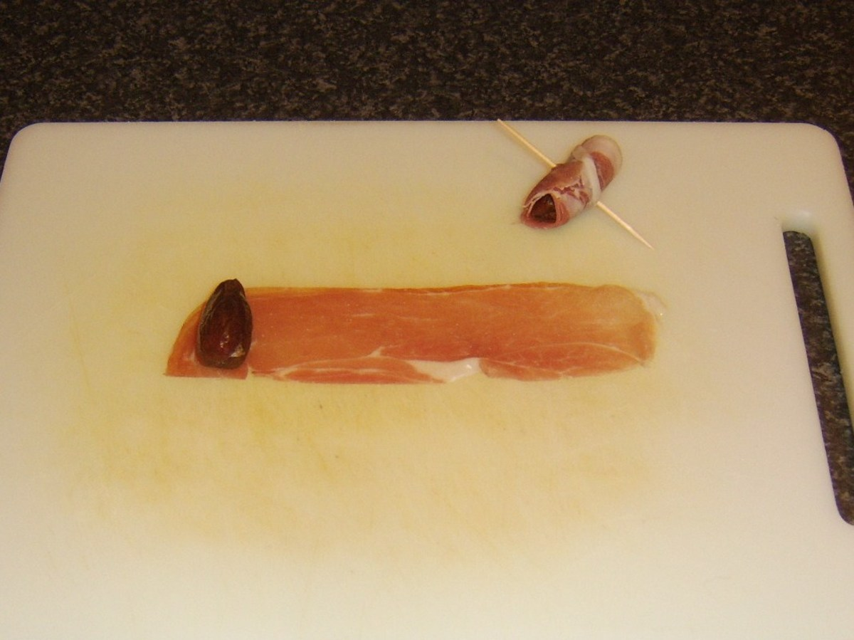 Parma ham strips are rolled around dates