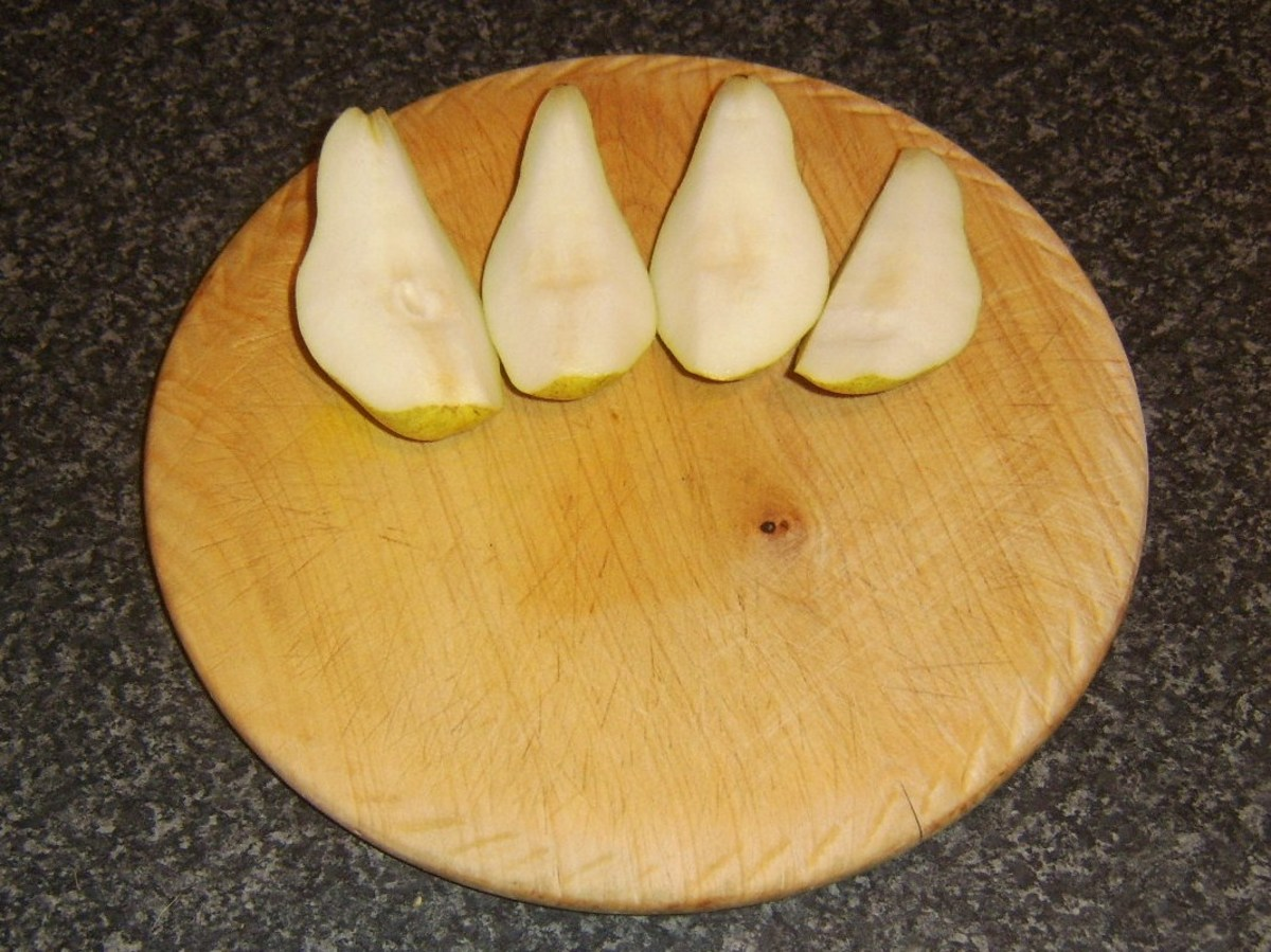 Pips and core are cut from pear quarters