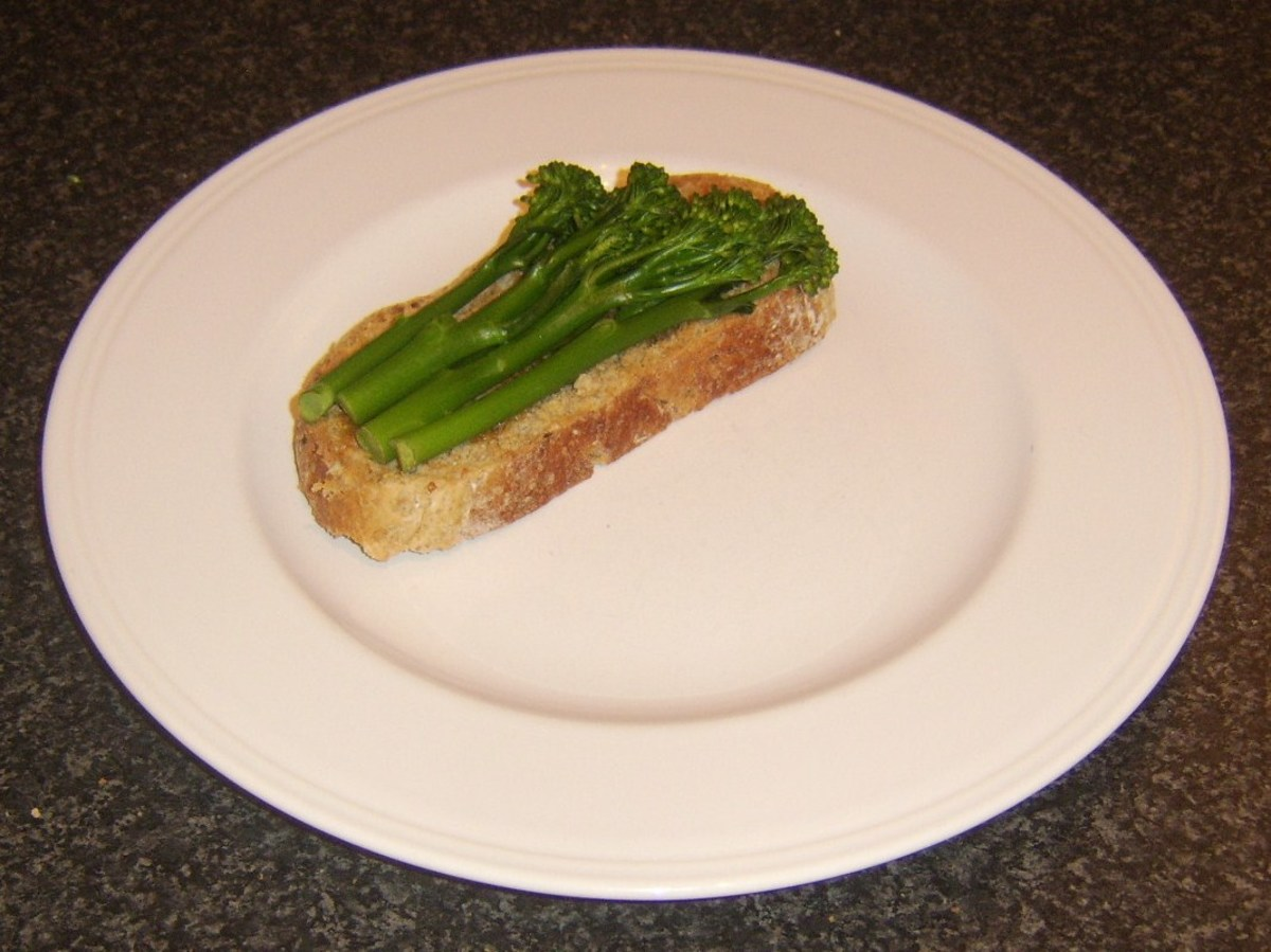 Drained tenderstem broccoli is laid on bruschetta