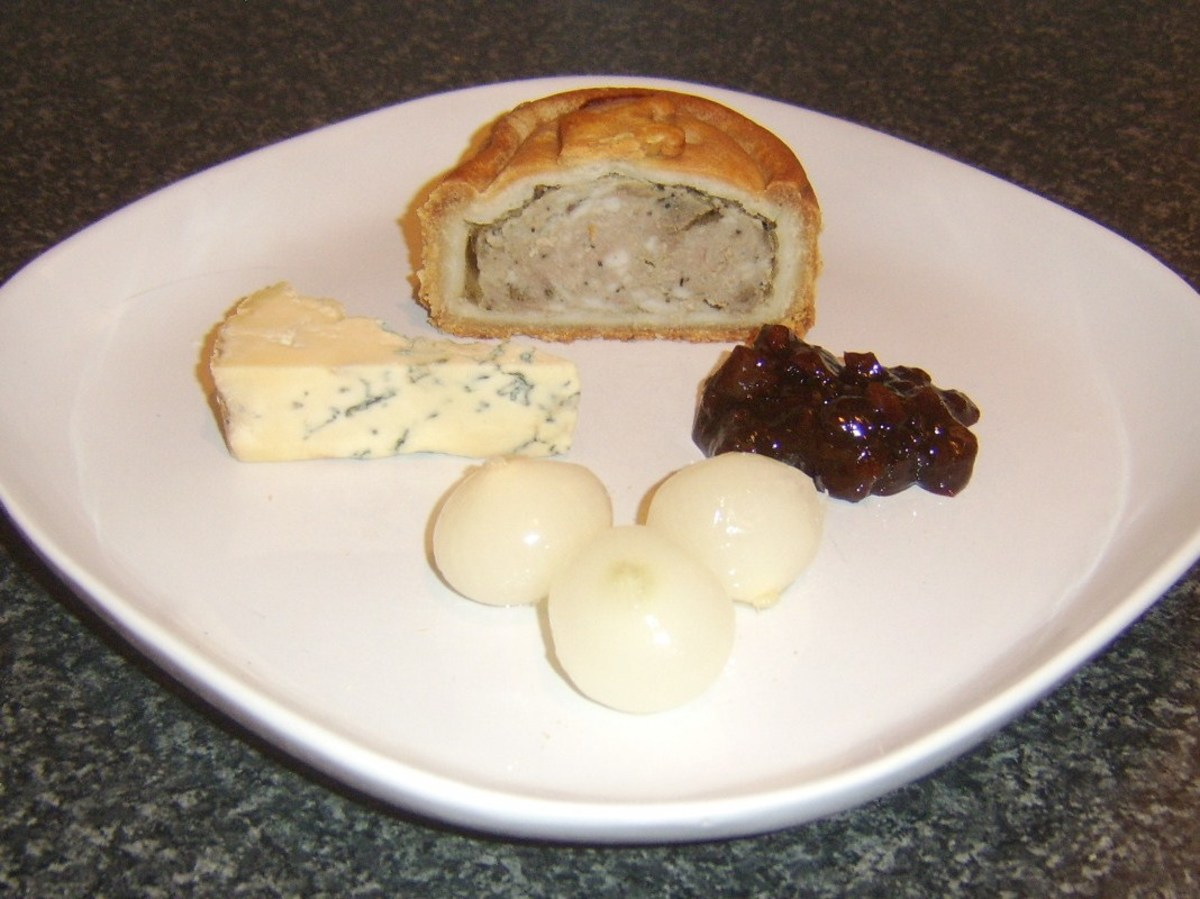 Stilton served with game pie and pickles