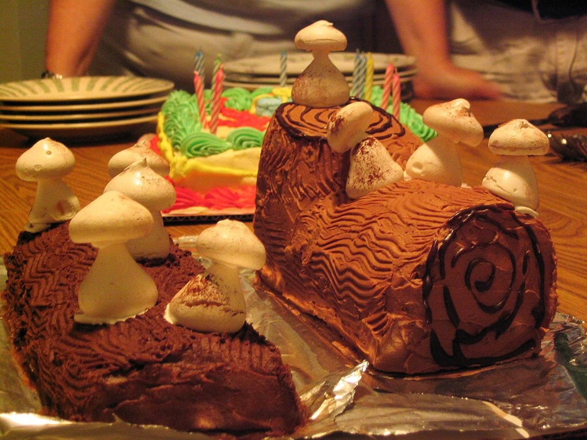 A Yule log cake with meringue mushrooms
