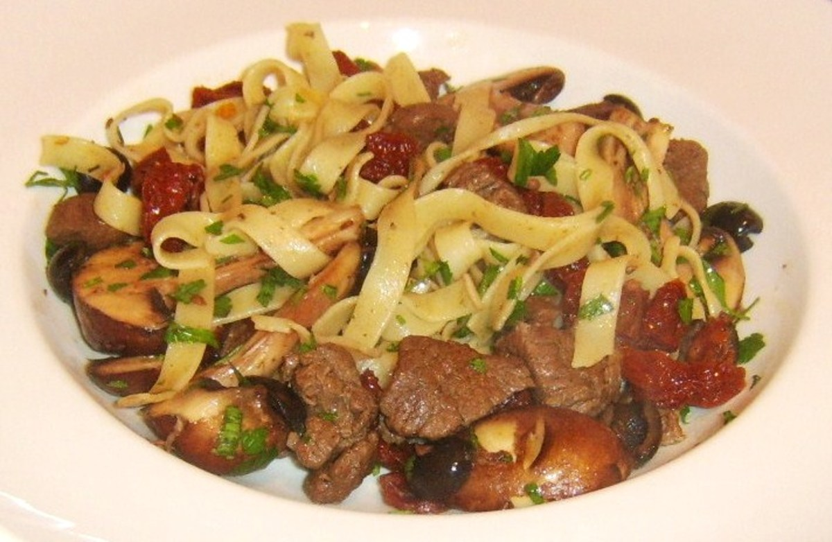 Venison, sun dried tomatoes, chestnut mushrooms and black olive tagliatelle pasta