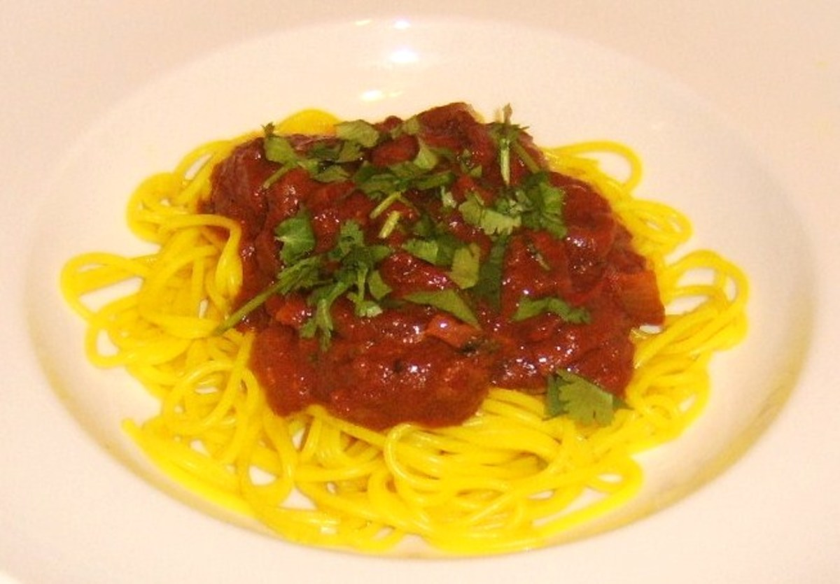 Venison curry sauce served on a bed of turmeric spiced spaghetti