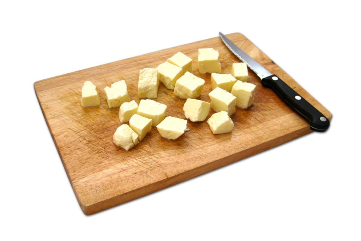 Cutting halloumi cheese into cubes.