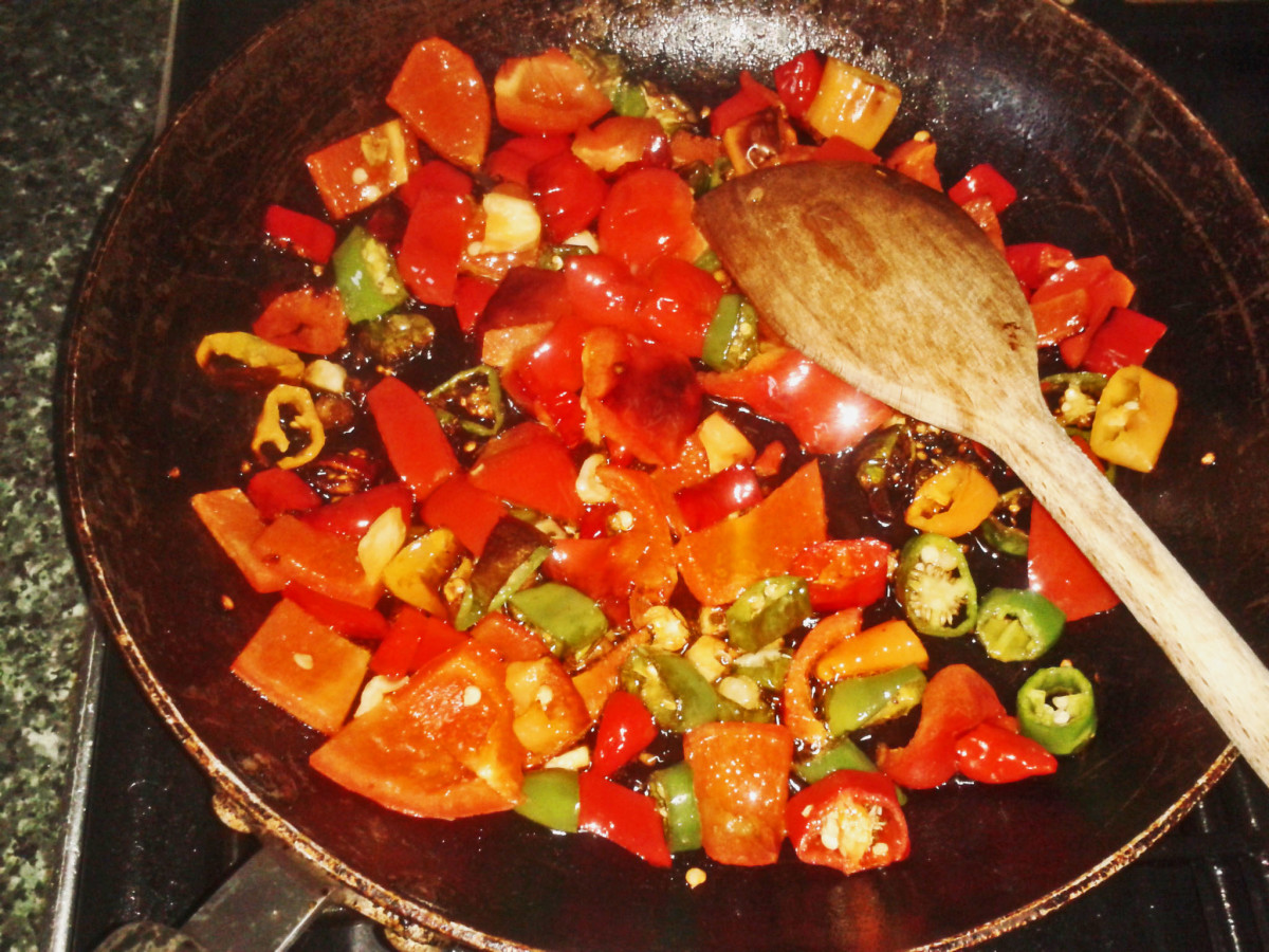 Chillies, red pepper and garlic frying
